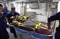 US Navy 050816-N-8213G-122 Medical personnel simulate an evacuation of a patient during deep rescue training aboard the Nimitz-class aircraft carrier USS Ronald Reagan (CVN 76).jpg