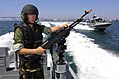 US Navy 060830-N-9818V-191 Gunner's Mate Seaman Justin Baker, assigned to Inshore Boat Unit One Three (IBU-13), mans a 7.62mm M-240 machine gun while conducting fast boat maneuvers during exercise Seahawk 2006.jpg