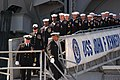 US Navy 070323-N-6645H-001 Sailors aboard USS John F. Kennedy (CV 67) file off the brow after receiving the order to disembark during the ship's decommissioning ceremony.jpg