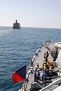 US Navy 071125-N-6794Z-001 Crew members aboard Pakistan Navy Ship (PNS) Babur prepare for an underway replenishment with the Military Sealift Command fleet replenishment oiler USNS John Leventhall