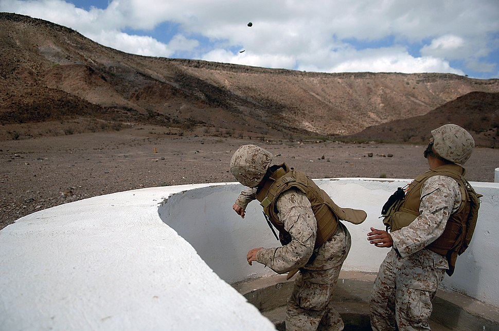 US Navy 080123-F-1644L-044 A Marine assigned to the 3rd Low Altitude Air Defense Battalion, throws a M-67 Fragment Grenade at the firing range