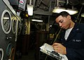 US Navy 080926-N-4236E-014 Machinist's Mate 3rd Class Jason Ferrante takes readings in the engine room.jpg