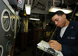 Machinist's mate - Image: US Navy 080926 N 4236E 014 Machinist's Mate 3rd Class Jason Ferrante takes readings in the engine room