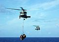 US Navy 081018-N-1062H-068 An SH-60F Sea Hawk transports cargo from the Military Sealift Command cargo-ammunition ship USNS Alan Shepard (T-AKE 3).jpg