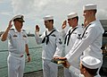 US Navy 081114-N-2218M-001 Cmdr. M.J. Tesar, commanding officer of the Los Angeles-class attack submarine USS Cheyenne (SSN 773) conducts a triple reenlistment ceremony aboard the USS Bowfin Museum at Pearl Harbor Memorial Park.jpg