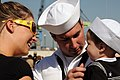 US Navy 090417-N-0649J-006 Mineman 3rd Class Thomas Goddard is reunited with his wife and their son after the mine countermeasures ship USS Chief (MCM 14) transited from Ingleside, Texas to San Diego.jpg