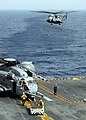 US Navy 090701-N-3165S-192 A CH-53E Super Stallion helicopter prepares to land aboard the amphibious assault ship USS Bataan (LHD 5).jpg
