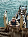 US Navy 091125-N-6156A-001 Adm. J. C. Harvey Jr., commander, U.S. Fleet Forces Command, climbs aboard the Al Basra Oil Terminal.jpg