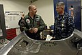US Navy 091201-N-9818V-038 Master Chief Petty Officer of the Navy (MCPON) Rick West talks with Aviation Structural Mechanic 1st Class Michael McKown during a tour of the hangar spaces of Carrier Air Wing (CVW) 14.jpg