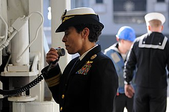 Rear admiral - US Navy Rear Admiral Michelle J. Howard uses the public address system to address the crew of USS Wasp in 2009. Howard has since been promoted to admiral.