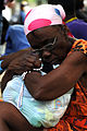 US Navy 100120-N-6247V-082 A Haitian woman clutches her rosary beads as an injured family member awaits treatment at the Killick Haitian Coast Guard Clinic.jpg
