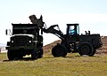 US Navy 100120-N-8241M-078 Seabees operate a front loader at the airfield at Naval Station Guantanamo Bay.jpg