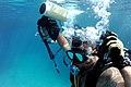 US Navy 100323-N-0553R-029 Explosive Ordnance Disposal Technician 1st Class Eddie Sharpe submerges during AN-PQS 2A (2 Alpha) hand held sonar training.jpg