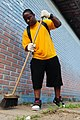 US Navy 100428-N-9301W-649 Culinary Specialist 1st Class Shon Coffie, assigned to guided-missile frigate USS Klakring (FFG 42), sweeps the walkway of the Eschol Municipal Fernando Presidio youth school as American and Brazilian.jpg