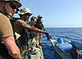 US Navy 100513-N-1082Z-060 Members of the visit, board, search and seizure team from the amphibious dock landing ship USS Ashland (LSD 48) speak with crew members of a fishing dhow.jpg