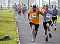 US Navy 100519-N-7367K-001 A Sailor and a Soldier based in southern Mississippi sprint to the finish line during the Run for Relief 5K Challenge.jpg