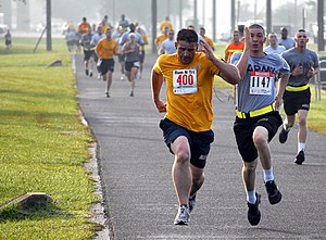 Racing - Two men engaging in a sprint finish at the end of a 5-kilometre road running competition