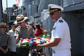US Navy 100703-N-3038C-207 Cmdr. Stephen Fuller, right, commanding officer of the guided-missile frigate USS Hawes (FFG 53) and a National Park Service ranger prepare to place a wreath in the water to honor World War II.jpg