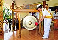 US Navy 100713-N-6410J-269 Capt. Lisa M. Franchetti, commander of Pacific Partnership 2010, bangs a gong during the opening ceremony in Indonesia.jpg