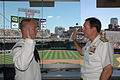 US Navy 100721-N-9688S-364 Vice Adm. Jay Donnelly re-enlists Engineman 2nd Class Brian Birdsall during Twin Cities Navy Week. Twin Cities Navy Week is one of 20 Navy Weeks planned across America for 2010.jpg