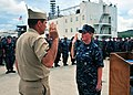 US Navy 100805-N-6165A-003 Machinist's Mate 3rd Class Hollie Davison repeats the oath of reenlistment to Rear Adm. Paul Bushong.jpg