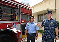 US Navy 101001-N-1906L-025 Capt. Richard Wood discusses the features of a new fire truck with Nicholas Perez following a ribbon cutting ceremony.jpg