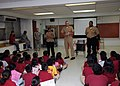 US Navy 101020-N-6165A-003 Sailors assigned to the submarine tender USS Frank Cable (AS 40) speak to a class of Price Elementary first grade studen.jpg