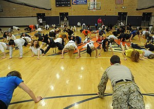 """Cooper High School (Abilene, Texas) - (Jan. 27, 2011) U.S. Navy SEALs lead exercises at Cooper High School. The SEALs also held a """"Mental Toughness"""" presentation to promote Naval special warfare awareness."""