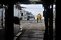 US Navy 110517-N-ZZ999-005 A chief petty officer speaks with a Sailor near an MH-60S Sea Hawk helicopter assigned to the Wild Cards of Helicopter S.jpg