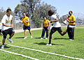 US Navy 110622-N-CW427-033 Sailors cheer students while they complete an obstacle course during a physical fitness field day.jpg