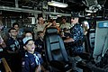 US Navy 110903-N-MN502-024 Lt. Cameron Mackley, electronic materiials officer aboard the littoral combat ship USS Independence (LCS 2), explains t.jpg
