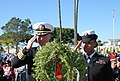 US Navy 111210-N-PQ745-093 Capt. Scott Adams, commanding officer of Naval Base Point Loma, and Engineman 3rd Class Kenitha Taylor render honors dur.jpg