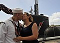 US Navy 111221-N-UK333-093 Sonar Technician (Submarine) 1st Class Philip Martinez is greeted with a kiss by his wife as he disembarks first from th.jpg