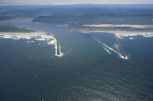 English: Aerial view of the mouth of the Umpqu...