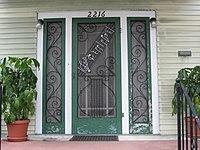 """Front door of Nick LaRocca's house in Uptown New Orleans has the opening notes of """"Tiger Rag"""" in the door screen"""