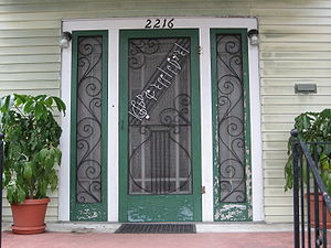 "Tiger Rag - Front door of Nick LaRocca's house in Uptown New Orleans has the opening notes of ""Tiger Rag"" in the door screen"