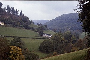 Eglwyseg - The lower part of the Eglwyseg valley, near Hendre, showing its characteristic landscape of woods and steeply sloping pastures.
