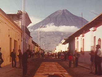 Volcán de Agua - Volcán de Agua, seen from Antigua, Guatemala, with temporary street carpeting for Easter celebrations in foreground.