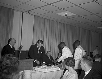 Robert E. Jones Jr. - Wernher von Braun's 50th Birthday Party was celebrated at the Officers Club at Redstone Arsenal on March 23, 1962. Dr. von Braun cuts his birthday cake while Congressman Bob Jones looks on.