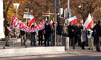 """God, Honour, Fatherland - """"Bóg, Honor, Ojczyzna"""" motto on a banner carried by participants of the Polish Day of Independence celebrations in 2011."""