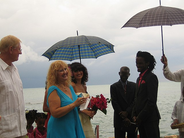 Jamaican wedding in the rain By Jacob Gordon [CC BY 2.0 (https://creativecommons.org/licenses/by/2.0)], via Wikimedia Commons