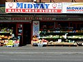 """Wilmslow Road - """"The Curry Mile"""" - Rusholme, Manchester - panoramio.jpg"""