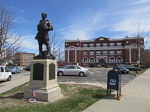 U.S. Route 44 - Taunton Plaza, at the triangle created by Route 44 (Taunton Avenue), Whelden Avenue, and Broadway in East Providence, features a Doughboy statue by Pietro Montana and the former East Providence High School.
