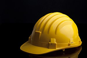 Yellow hard hat. Studio photography.