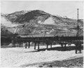 """""""River ice which accumulated above the conveyor trestle crossing the Columbia River."""" - NARA - 294243.tif"""