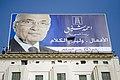 الثوار يمزقون لوحة إعلانات مرشح الفلول أحمد شفيق.jpg