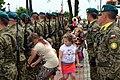 02014 Kinder sammeln Patronenhülsen auf.JPG