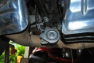 Four-stroke power valve system - The exhaust power valve of a 2007 Honda CBR600RR.