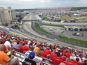 2013 NASCAR Sprint Cup Series - Kyle Busch leads the FedEx 400 ahead of Matt Kenseth through the third turn.