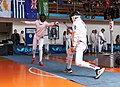 2nd Leonidas Pirgos Fencing Tournament. Extension and touch for the fencer on the left.jpg